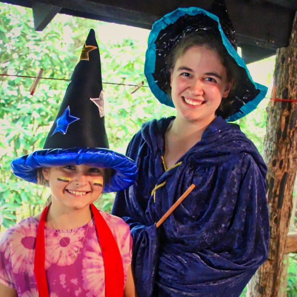 camp counselor and camper dressed in wizard costume