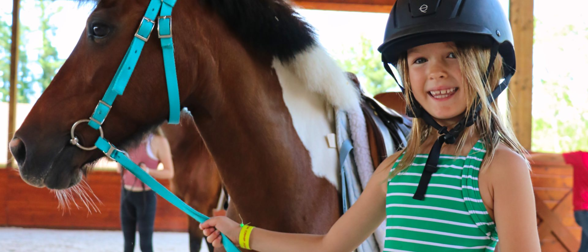 young equestrienne at camp