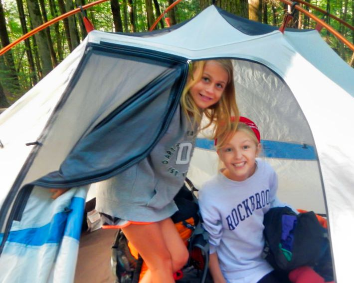 girls inside camping tent