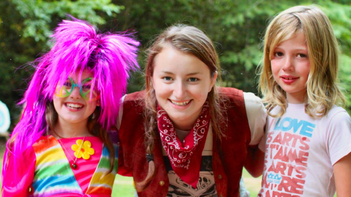 counselor and two campers in costume