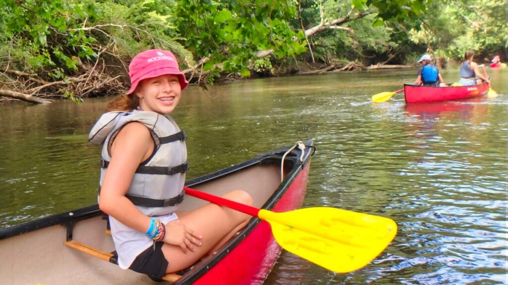 camp girl canoeing trip on French Broad
