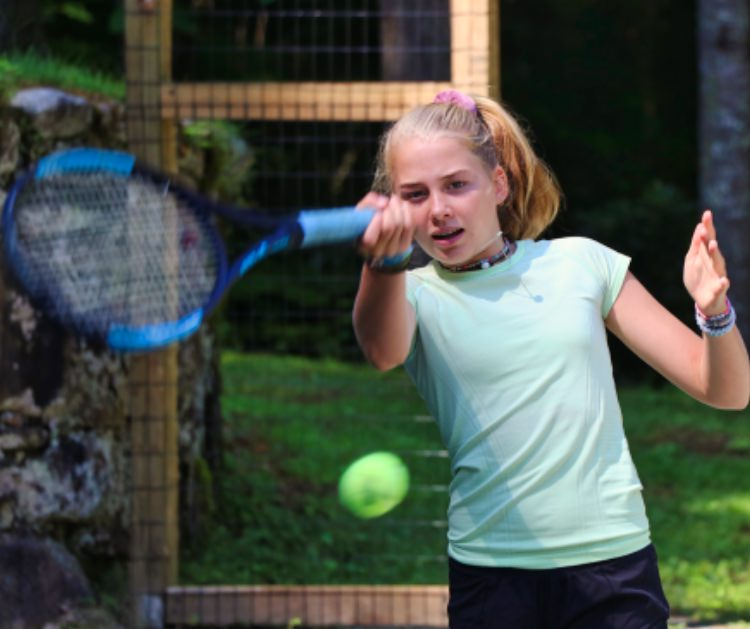 learning tennis at summer camp