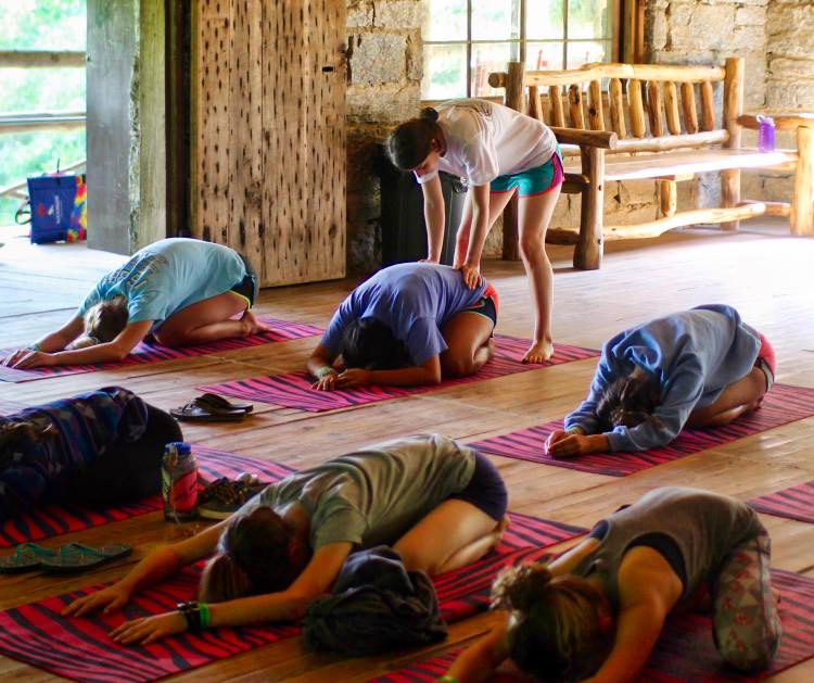 camp group stretching in yoga class