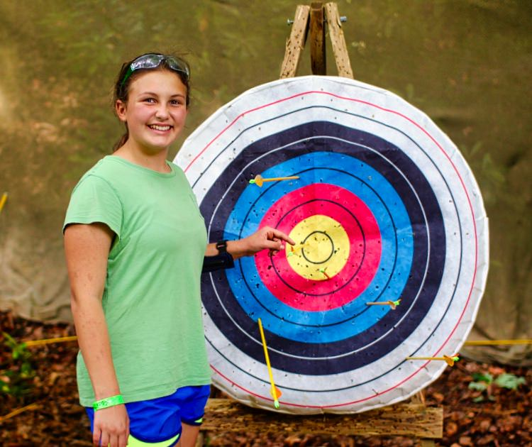 girl with bullseye archery target