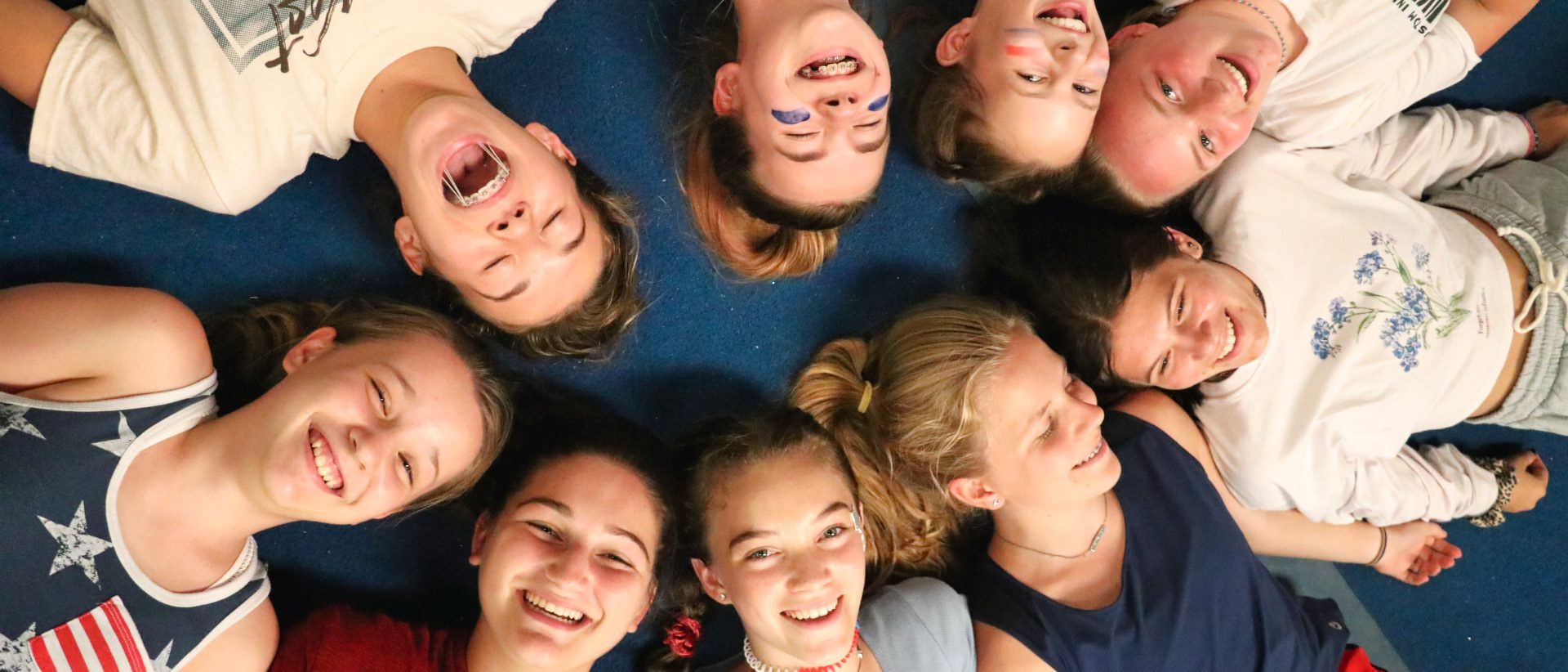 camps girls lying down in circle