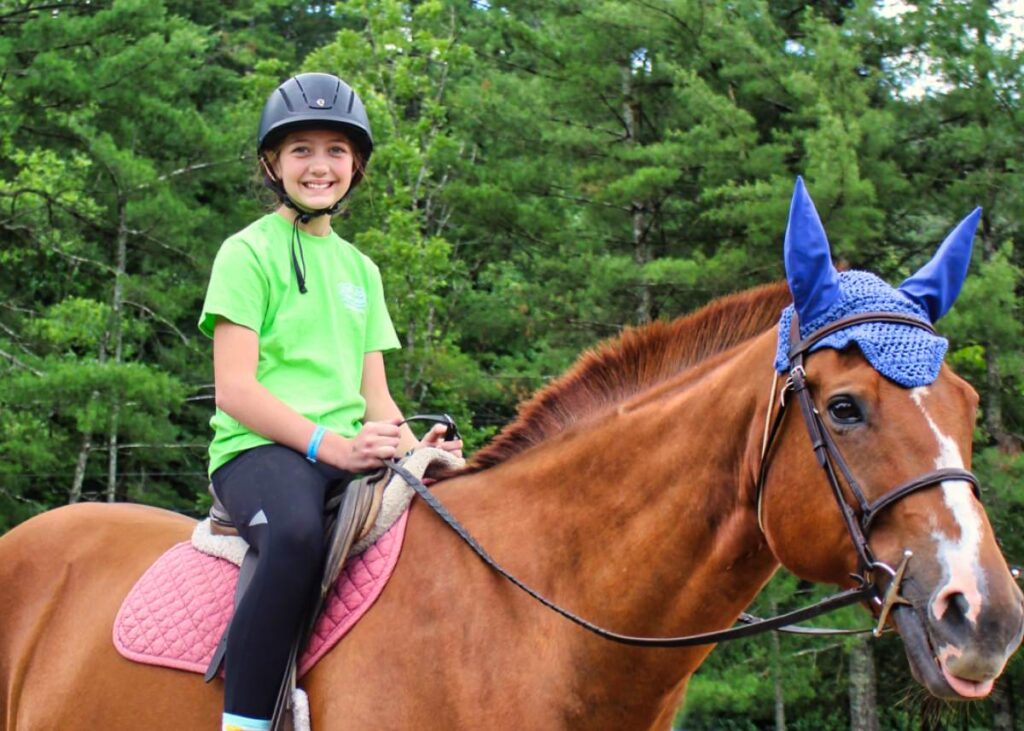 overnight summer camp kid on horseback