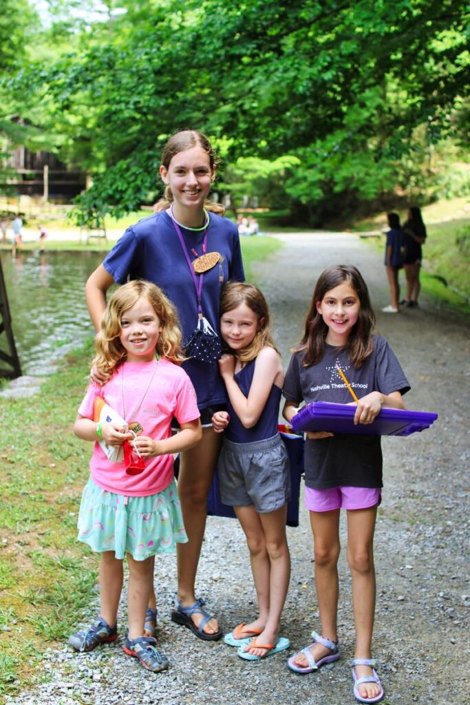 camp counselor with children