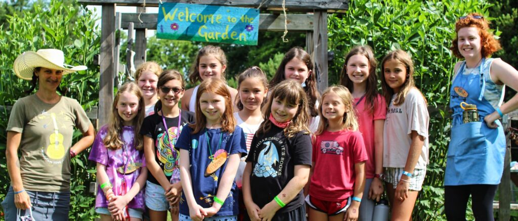 group of young campers at the garden with their teachers