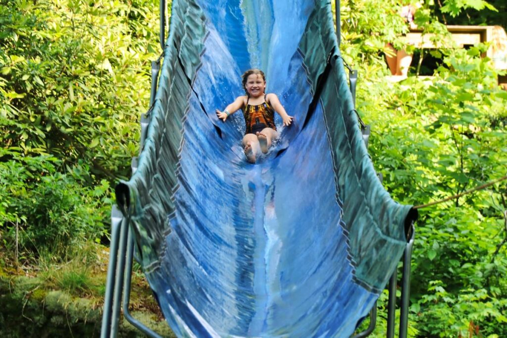 Waterslide child at summer camp