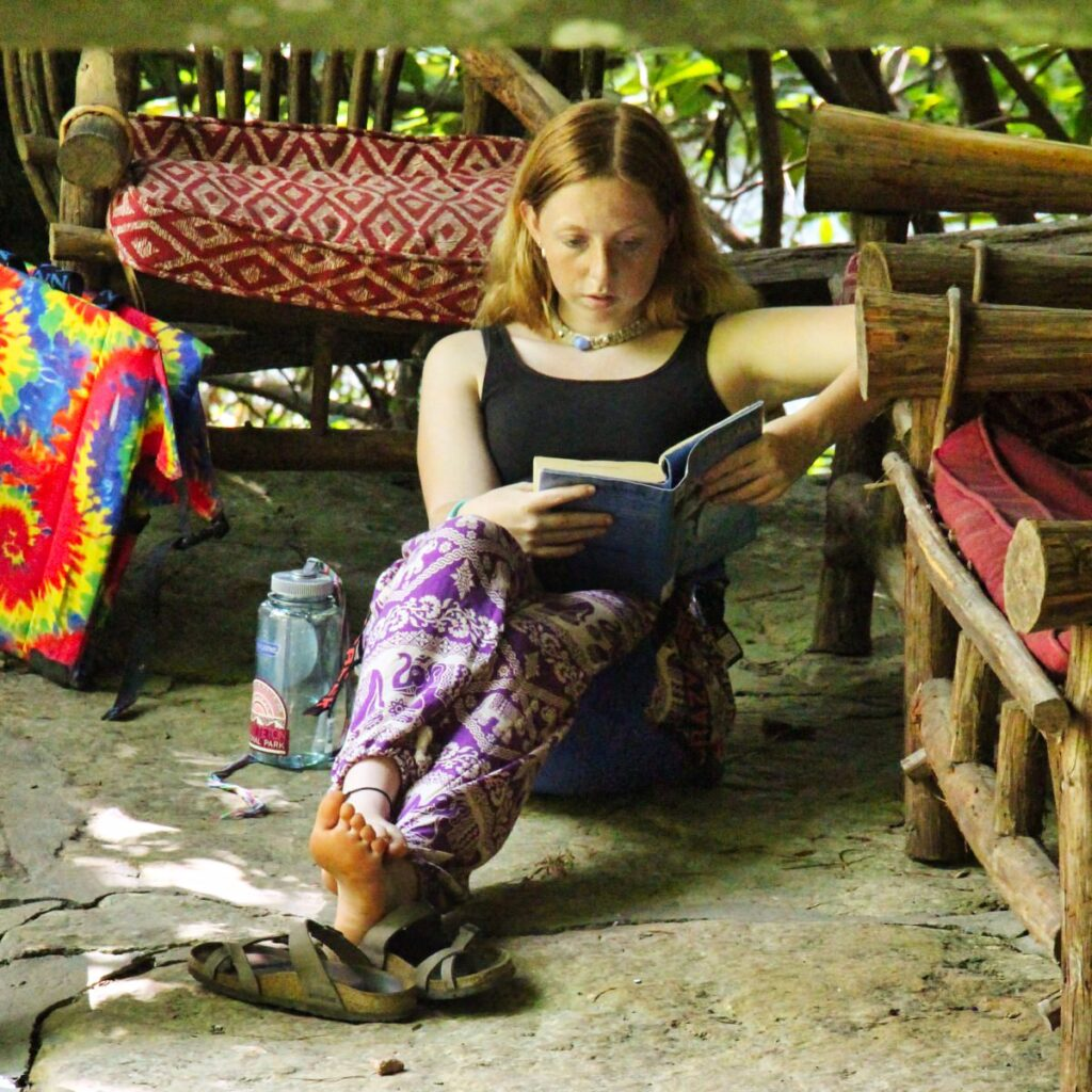 camp girl reading outdoors