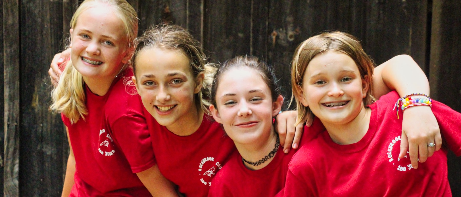 camp girls dressed all in red